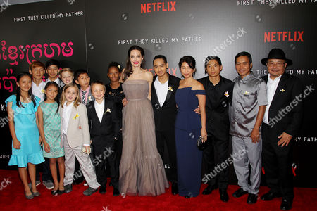 Stock Photo of Cast with Angelina Jolie (Dir., Co-Writer,Producer), Maddox Jolie-Pitt, Loung Ung (Co-Writer, Author), Pax Jolie-Pitt, Rithy Panh (Producer), Kompheak Phoeung