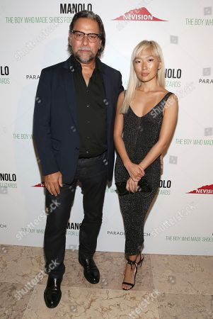 """Stock Picture of Sante D'Orazio, Enga Purevjav. Photographer Sante D'Orazio and Enga Purevjav attend the world premiere of, """"Manolo: The Boy Who Made Shoes For Lizards"""", hosted by Manolo Blahnik and The Cinema Society, at The Frick Collection, in New York"""