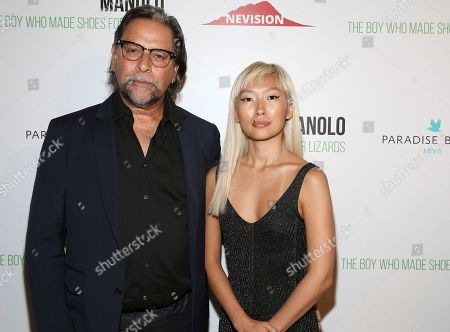 """Stock Photo of Sante D'Orazio, Enga Purevjav. Photographer Sante D'Orazio and Enga Purevjav attend the world premiere of, """"Manolo: The Boy Who Made Shoes For Lizards"""", hosted by Manolo Blahnik and The Cinema Society, at The Frick Collection, in New York"""
