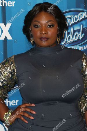 """Candice Glover arrives at the """"American Idol"""" farewell season finale at the Dolby Theatre, in Los Angeles"""