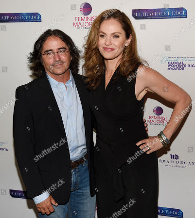 Honoree Amy Brenneman, right, poses with her husband Brad Silberling at the 11th Annual Global Women's Rights Awards at the Directors Guild of America, in Los Angeles