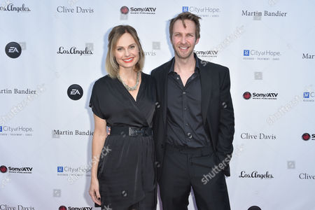 Stock Image of Annie Little, left, and Marcus Ashley arrive at the 11th annual Songs Of Hope benefit, in Los Angeles