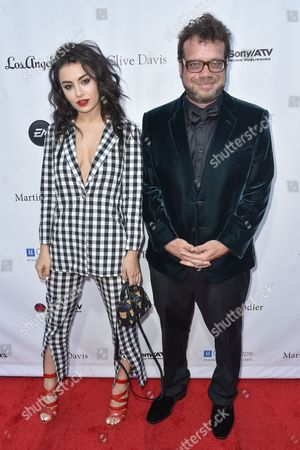 Charli XCX, left and Christophe Beck arrive at the 11th annual Songs Of Hope benefit, in Los Angeles