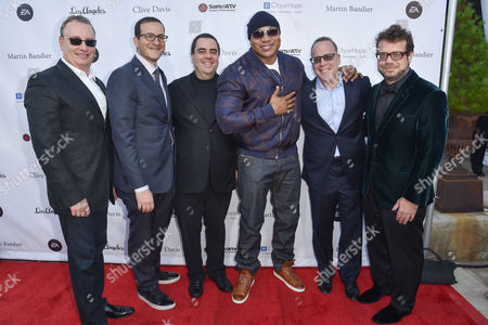 Chairman of Spirit Music Group David Renzer, from left, Doug Davis, President of the Universal Music Publishing Group Evan Lamberg, LL Cool J, Worldwide Executive, Music and Music Marketing for Electronic Arts Steve Schnur, and Christophe Beck arrive at the 11th annual Songs Of Hope benefit, in Los Angeles