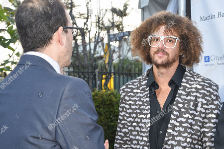 Ron Fair, left, and Stefan Kendal Gordy (Redfoo) arrive at the 11th annual Songs Of Hope benefit, in Los Angeles