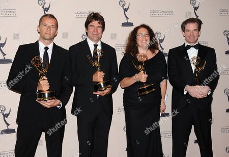 From left, John Battsek, Greg Barker, Julie Goldman and Peter Bergen poses in the press room at the 2013 Primetime Creative Arts Emmy Awards, on at Nokia Theatre L.A. Live, in Los Angeles, Calif