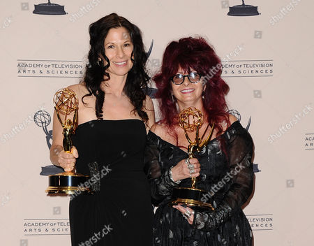 Stock Photo of From left, Deborah Rutherford and Deborah Lamia Denaver pose in the press room at the 2013 Primetime Creative Arts Emmy Awards, on at Nokia Theatre L.A. Live, in Los Angeles, Calif