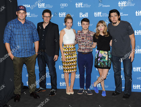 """Stock Image of Michael Dowse, from left, Elan Mastai, Megan Park, Daniel Radcliffe, Zoe Kazan, and Adam Driver attend the press conference for """"The F Word"""" on day 4 of the Toronto International Film Festival at the TIFF Bell Lightbox, in Toronto"""