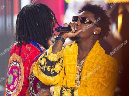 "Stock Picture of Quavious ""Quavo"" Marshall and Kiari ""Offset"" Cephus of Migos performs at the 2014 BET Hip Hop Awards held at the Atlanta Civic Center, in Atlanta"