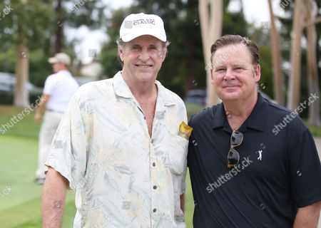 Robert Hays, left, and Joel Murray participate in a tournament at the 15th Emmys Golf Classic, presented by the Television Academy Foundation, at the Wilshire Country Club in Los Angeles