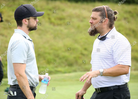 Rob McElhenney, left, and Jay Ferguson participate in a tournament at the 15th Emmys Golf Classic, presented by the Television Academy Foundation, at the Wilshire Country Club in Los Angeles