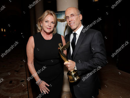 Suzanne Lloyd presents Jeffrey Katzenberg with the Harold Lloyd Filmmaker award at the 2014 International 3D and Advanced Imaging Society's Creative Arts Awards at the Steven J. Ross Theatre, Warner Bros. Studios on in Burbank, California