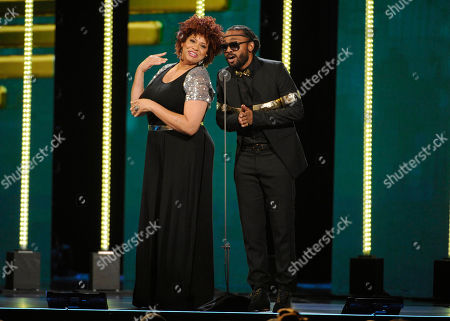 Stock Image of Kim Coles, left, and Machel Montano speak on stage during the 2014 Soul Train Awards at Orleans Arena, in Las Vegas