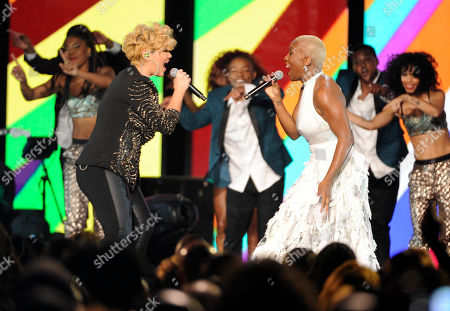 Tessanne Chin, left, and Liv Warfield perform during the 2014 Soul Train Awards at Orleans Arena, in Las Vegas