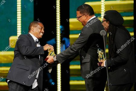 """Robert """"Kool"""" Bell, left, of Kool & The Gang accepts the Soul Train Legend award from Judge Mathis, center, and Nile Rodgers during the 2014 Soul Train Awards at Orleans Arena, in Las Vegas"""