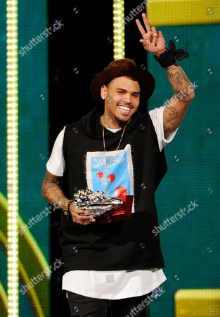 """Singer Chris Brown accepts the Best Collaboration award for his song """"Loyal"""" with Lil Wayne and Tyga during the 2014 Soul Train Awards at Orleans Arena, in Las Vegas"""