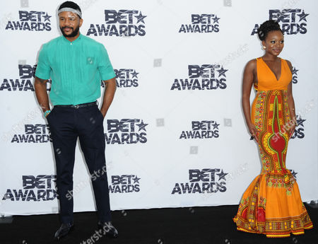 Hosea Chanchez, left, and Naturi Naughton pose in the press room at the BET Awards at the Microsoft Theater, in Los Angeles