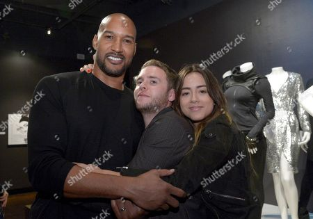 Henry Simmons, from left, Iain De Caestecker and Chloe Bennet seen at The 9th Annual Outstanding Art of Television Costume Design Exhibition opening at the FIDM Museum & Galleries on the Park, in Los Angeles. The Television Academy and FIDM Museum honored this year Emmy(R) Award winners in Outstanding Costume Design at the opening reception for this annual special exhibition