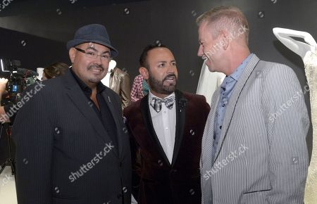 """Christopher Lawrence, costume designer of """"Ray Donovan"""", from left, Nick Verreos and Salvador Perez, costume designer of """"The Mindy Project"""" seen at The 9th Annual Outstanding Art of Television Costume Design Exhibition opening at the FIDM Museum & Galleries on the Park, in Los Angeles. The Television Academy and FIDM Museum honored this year's Emmy(R) Award winners in Outstanding Costume Design at the opening reception for this annual special exhibition"""