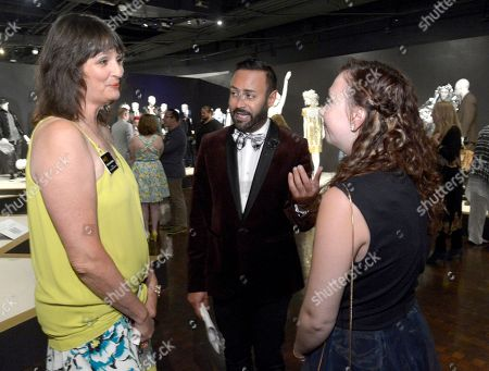 The Television Academy's Terry Ann Gordon, from left, Nick Verreos and Polly Gregory seen at The 9th Annual Outstanding Art of Television Costume Design Exhibition opening at the FIDM Museum & Galleries on the Park, in Los Angeles. The Television Academy and FIDM Museum honored this year's Emmy(R) Award winners in Outstanding Costume Design at the opening reception for this annual special exhibition