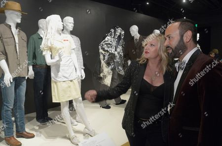"""Nick Verreos, right, and Mona May, costume designer of """"Whitney"""" seen at The 9th Annual Outstanding Art of Television Costume Design Exhibition opening at the FIDM Museum & Galleries on the Park, in Los Angeles. The Television Academy and FIDM Museum honored this yearâ?™s Emmy(R) Award winners in Outstanding Costume Design at the opening reception for this annual special exhibition"""