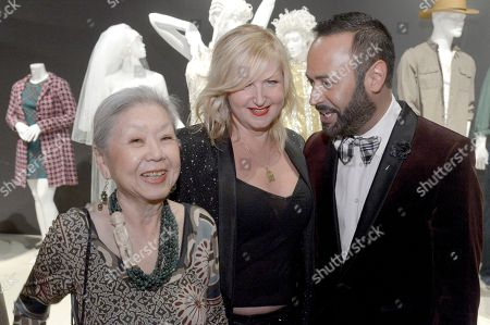 """Mary Rose, from left, Nick Verreos, and Mona May, costume designer of """"Whitney"""" seen at The 9th Annual Outstanding Art of Television Costume Design Exhibition opening at the FIDM Museum & Galleries on the Park, in Los Angeles. The Television Academy and FIDM Museum honored this year's Emmy(R) Award winners in Outstanding Costume Design at the opening reception for this annual special exhibition"""