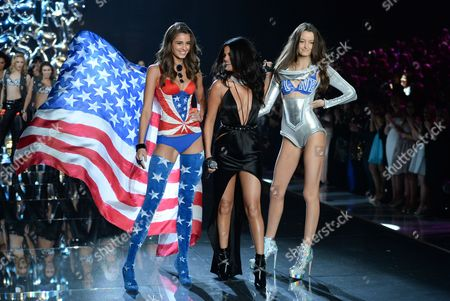 Model Taylor Hill, left, singer Selena Gomez and model Megan Puleri walk the runway during the 2015 Victoria's Secret Fashion Show at the Lexington Armory, in New York. The Victoria's Secret Fashion Show will air on CBS on Tuesday, December 8th at 10pm EST
