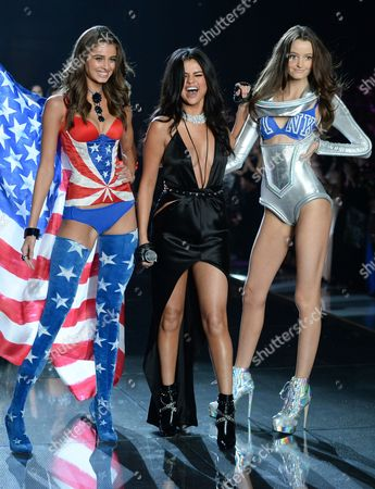 Model Taylor Hill, left, singer Selena Gomez and model Megan Puleri walk the runway during the 2015 Victoria's Secret Fashion Show at the Lexington Armory, in New York. The Victoria Secret Fashion Show will air on CBS on Tuesday, December 8th at 10pm EST