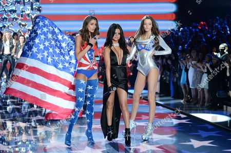 Model Taylor Hill, left, singer Selena Gomez and model Megan Puleri walk the runway during the 2015 Victoria's Secret Fashion Show at the Lexington Armory, in New York. The Victoriaâ?™s Secret Fashion Show will air on CBS on Tuesday, December 8th at 10pm EST