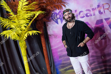 Coleman Hell poses in the press room at the 2016 iHeartRadio MuchMusic Video Awards, in Toronto, Canada