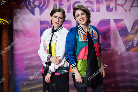 Sara Keirsten Quin, left, and Tegan Rain Quin of Tegan and Sara pose in the press room at the 2016 iHeartRadio MuchMusic Video Awards, in Toronto, Canada