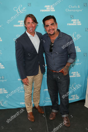 Honoree Chef John Besh and Chef Aaron Sanchez seen at the James Beard Foundation's Chefs & Champagne fundraiser, at Wolffer Estate Vineyard in Sagaponack, N.Y