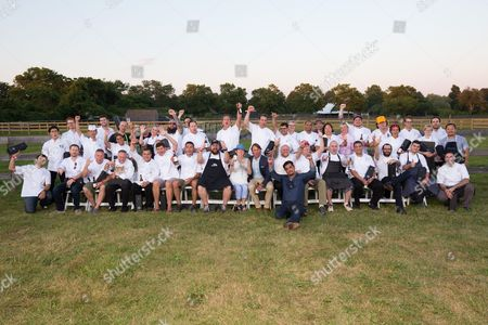 Center) James Beard Foundation President Susan Ungaro, and honoree (center) Chef John Beshseen sit for a portrait with 2016 Chefs of the James Beard Foundation's Chefs & Champagne fundraiser honoring John Besh, at Wolffer Estate Vineyard in Sagaponack, N.Y