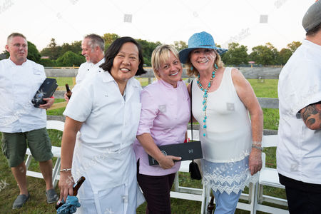 Chef Anita Lo, from left, Chef Sherry Yard and James Beard Foundation President Susan Ungaro are seen at the James Beard Foundation's Chefs & Champagne fundraiser honoring John Besh, at Wolffer Estate Vineyard in Sagaponack, N.Y