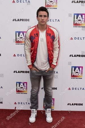 """Huw Collins arrives at the """"LA Pride Festival and Parade"""" event at the West Hollywood Park, in Los Angeles"""