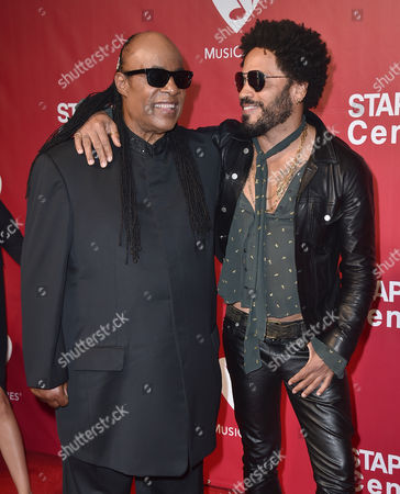 Stevie Wonder, left, and Lenny Kravitz arrive at the MusiCares Person of the Year tribute honoring Lionel Richie at the Los Angeles Convention Center on