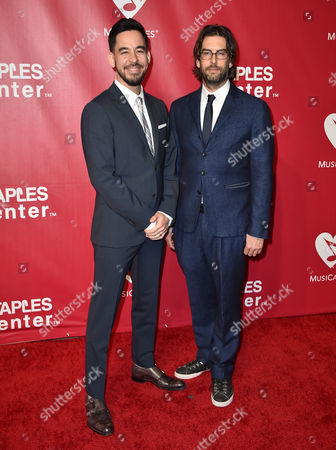 Mike Shinoda, left, and Rob Bourdon, of Linkin Park, arrive at the MusiCares Person of the Year tribute honoring Lionel Richie at the Los Angeles Convention Center on