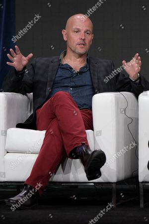 """Stock Picture of Peter Carlton participates in the """"International Intrigue"""" panel during the Hulu Television Critics Association summer press tour, in Beverly Hills, Calif"""