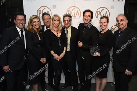 Stock Photo of EXCLUSIVE -Stewart A. Lyons, from left, Michelle MacLaren, Mark Johnson, Moira Walley-Beckett, Peter Gould, Adrien Brody, Melissa Bernstein, and Thomas Schnauz pose with the Norman Felton award for outstanding producer of episodic television drama for Breaking Bad at the 26th Annual Producers Guild Awards at the Hyatt Regency Century Plaza, in Los Angeles