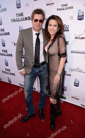 Stock Picture of Actor Kato Kaelin, left, and Leyna Nguyen attend The Thalians Gala benefiting Operation Mend at U.C.L.A. and honoring singer Smokey Robinson at the House of Blues on in West Hollywood, Calif
