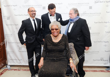 Maya Angelou, sitting, Mailer Prize for Distinguished Writing recipient Junot Diaz, back left, Alain Bernard, center, and Norman Mailer Center president and co-founder Lawrence Schiller, right, attend the fifth annual Norman Mailer Center benefit gala at the New York Public Library, in New York