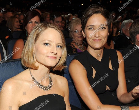 Actress Jodie Foster, left, and actress and wife Alexandra Hedison in the audience at the 66th Primetime Emmy Awards at the Nokia Theatre L.A. Live, in Los Angeles