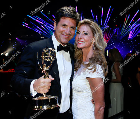 Steven Levitan, left, and Krista Levitan attend the Governors Ball at the 66th Primetime Emmy Awards at the Nokia Theatre L.A. Live, in Los Angeles