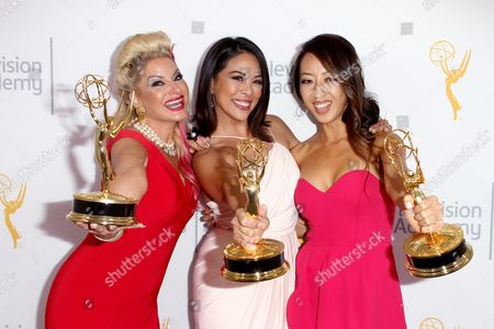 Kimberly Cornell, from left, Cher Calvin, and, Angel C. Kim, winners of the Emmy for L.A. Local Color for 'Stan Chambers: Legendary Newsman' pose for a portrait at the L.A. Area Emmy Awards presented at the Television Academy's new Saban Media Center, in the NoHo Arts District in Los Angeles