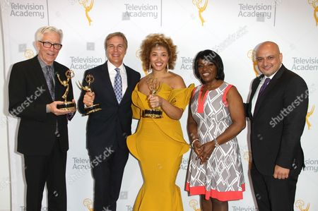 Fritz Coleman, winner of the Emmy for Education for 'El Nino: Currents of Change'?, from left, Robert Kovacik, Frava Burgess, winners of the Emmy for Culture/History for '50 Watts'?, and Beverly White pose for a portrait at the L.A. Area Emmy Awards presented at the Television Academy's new Saban Media Center, in the NoHo Arts District in Los Angeles