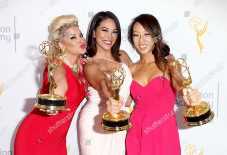 Kimberly Cornell, from left, Cher Calvin, and, Angel C. Kim pose for a portrait at the L.A. Area Emmy Awards presented at the Television Academy's new Saban Media Center, in the NoHo Arts District in Los Angeles