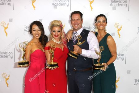 "EXCLUSIVE - Angel C. Kim, from left, Kimberly Cornell, Nick Simpson, and Lu Parker, winners of the Emmy for Medical News Story - Multi - Part Report ""3D Medical Technology: 3D Hand and Heart"" pose for a portrait at the L.A. Area Emmy Awards presented at the Television Academyâ?™s new Saban Media Center, in the NoHo Arts District in Los Angeles"