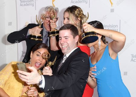 Fritz Coleman, from top left, Crystal Egger, bottom left, Marissa Slattery, David Biggar and Shanna Mendiola pose for a portrait at the L.A. Area Emmy Awards presented at the Television Academy new Saban Media Center, in the NoHo Arts District in Los Angeles