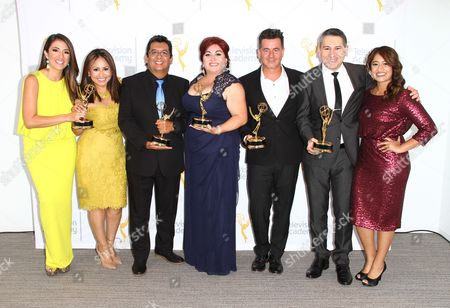 """EXCLUSIVE - Maity Interiano, from left, Nancy Mejia, Luis Enrique Rivera, Beatriz Gomez, Marcelo Gama, Alejandro Mendoza, and Angie Torres winners of the Emmy for Live Special Events - Programming """"Desfile De Las Rosas 2015"""" and guests pose for a portrait at the L.A. Area Emmy Awards presented at the Television Academy new Saban Media Center, in the NoHo Arts District in Los Angeles"""