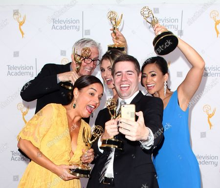 Fritz Coleman, from top left, Crystal Egger, bottom left, Marissa Slattery, David Biggar and Shanna Mendiola pose for a portrait at the L.A. Area Emmy Awards presented at the Television Academy's new Saban Media Center, in the NoHo Arts District in Los Angeles